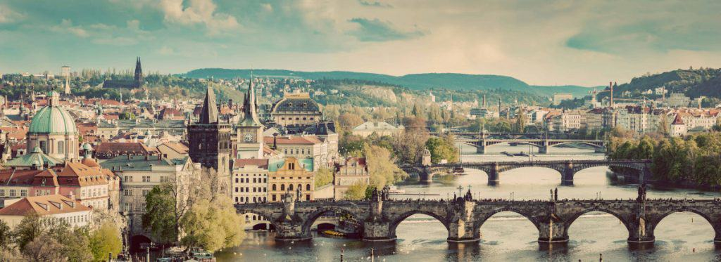 Prague, Czech Republic bridges skyline with historic Charles Bridge and Vltava river in the afternoon